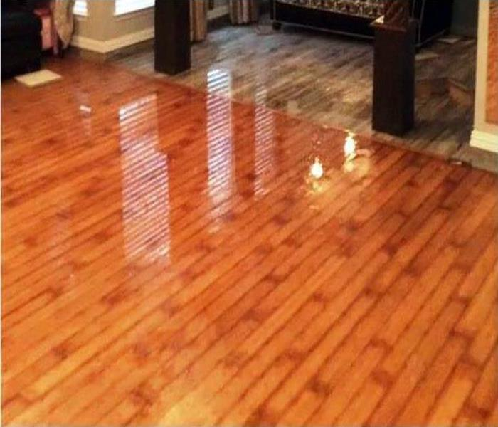 water covering wood flooring in a home