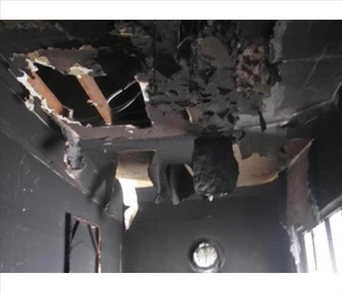 soot covered hanging fire damaged ceiling material