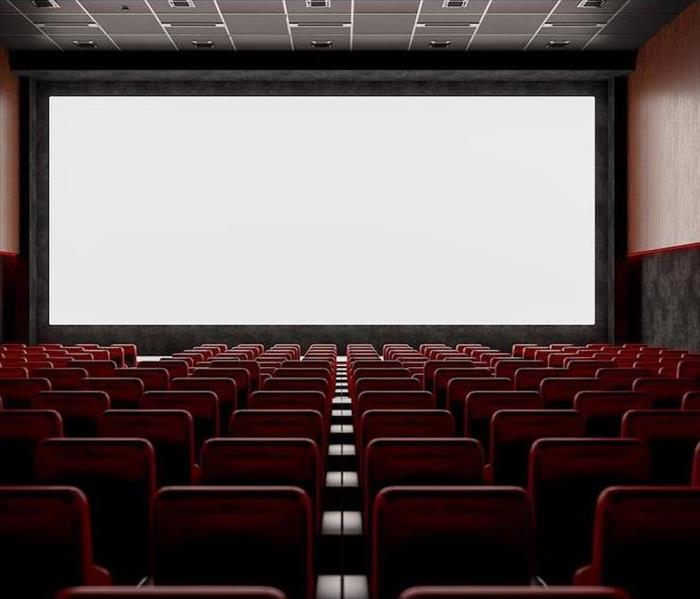 empty movie theater with large screen