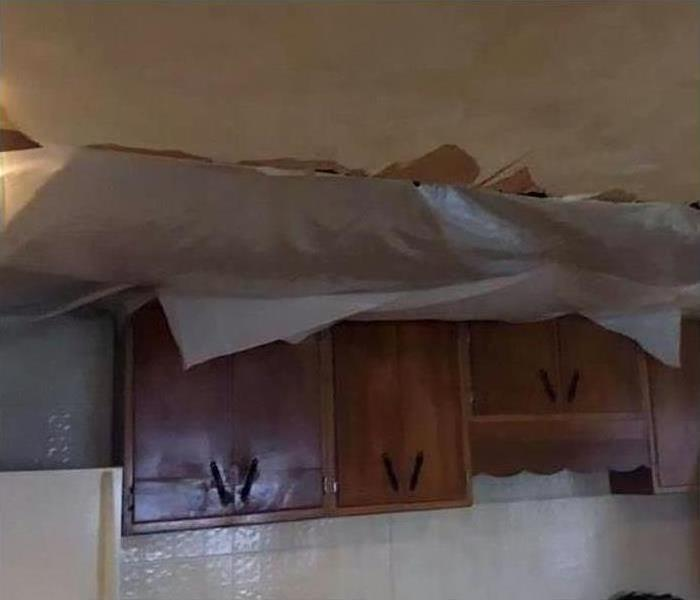 Storm Damage lead to water damage on the tops of these kitchen counters