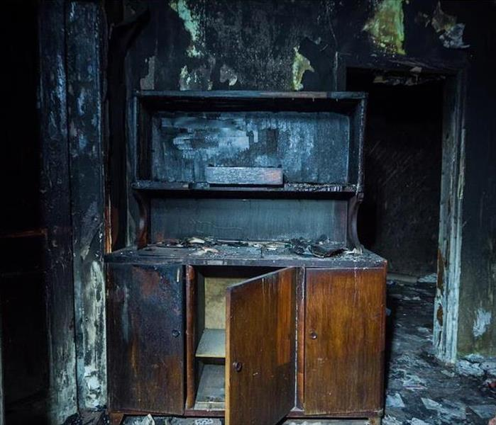 fire damaged cabinet in room